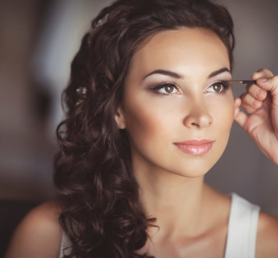 woman having makeup done