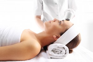 esthetician using ultrasound tool for skin care in Guelph